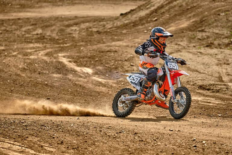 Boy at a motocross training session (perhaps the best dirt bike for kids)
