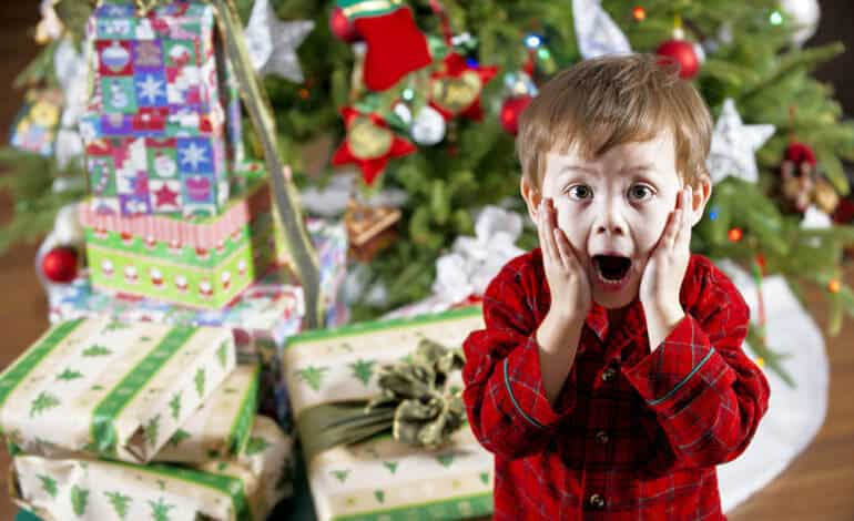boy is surprised with gifts