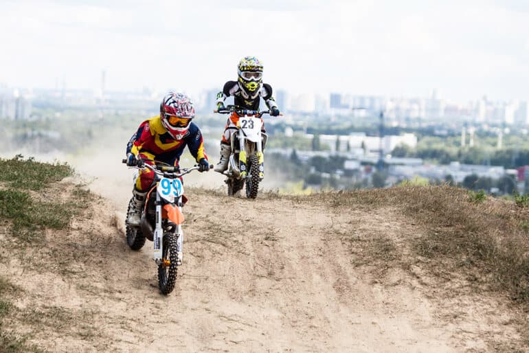 boys compete with each other on the best dirt bikes