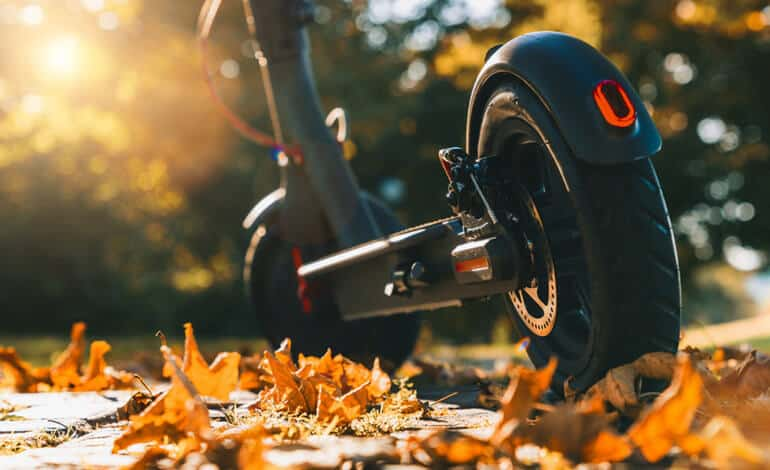 electric scooter on leaves