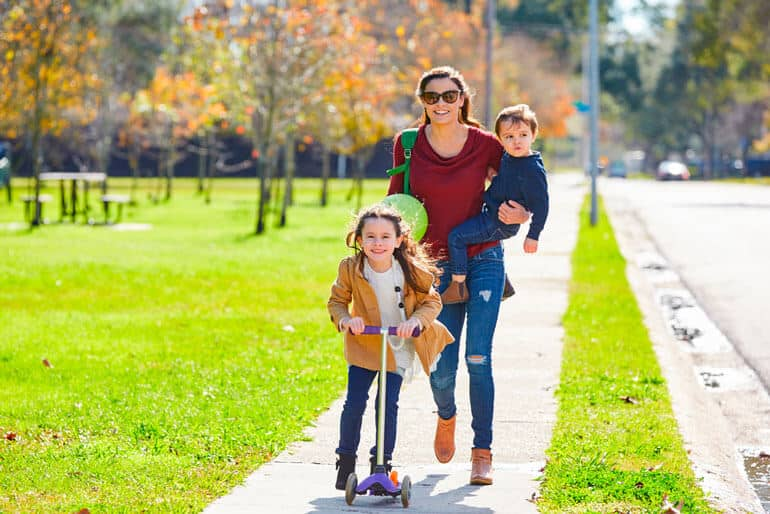 family strolling daughter scooting