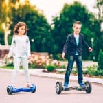 girl and boy riding hoverboard