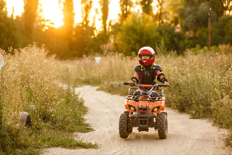 girl in red helmet ATVing