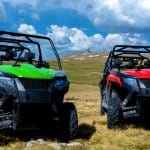 green and red utvs close up