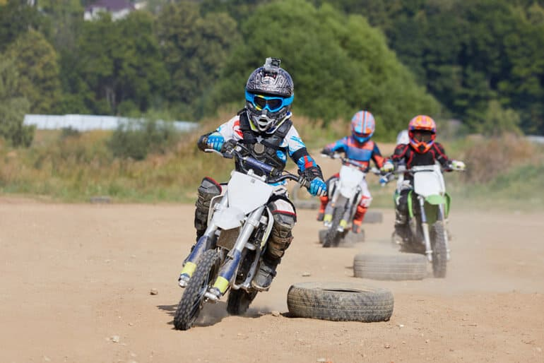kids are participating in a motocross race