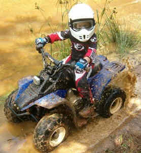 Kids four-wheeler trial riding