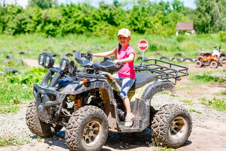 little girl riding adult atv