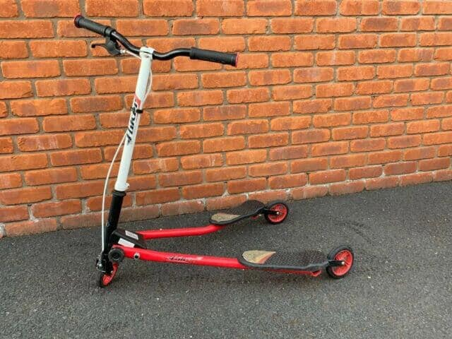 red and white wiggle scooter